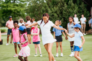 On the Green featured a junior girls' golf clinic as a way to personally connect tournament participants with the Play Like a Girl mission.